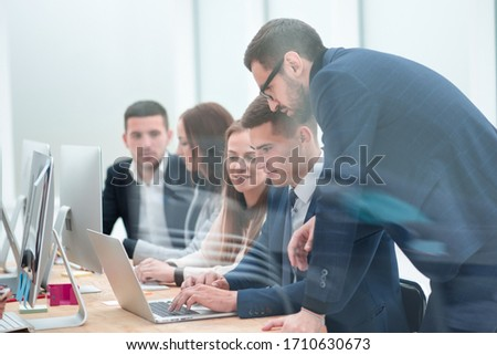 group of employees discussing new ideas together Royalty-Free Stock Photo #1710630673
