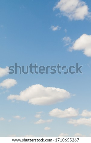 Blue Sunny sky, white Cumulus clouds lower layer of cloud cover, sky background . Royalty-Free Stock Photo #1710655267