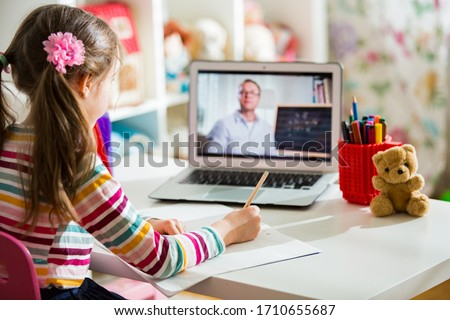 Middle-aged distance teacher having video conference call with pupil using webcam. Online education and e-learning concept. Home quarantine distance learning and working from home. #1710655687