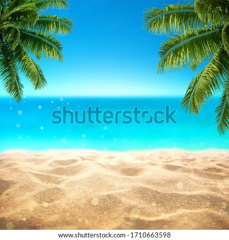 Summer sandy beach with blured tropical sea view with empty space for product display advertistment #1710663598