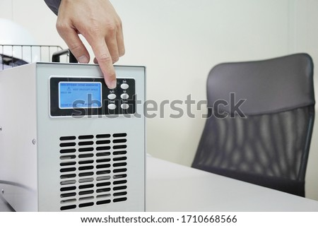 Ozone generators placed on the table in office room to cleaning and disinfection during corona-virus epidemic. (Covid 19) Royalty-Free Stock Photo #1710668566