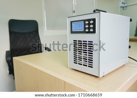 Ozone generators placed on the table in office room to cleaning and disinfection during corona-virus epidemic. (Covid 19) Royalty-Free Stock Photo #1710668659
