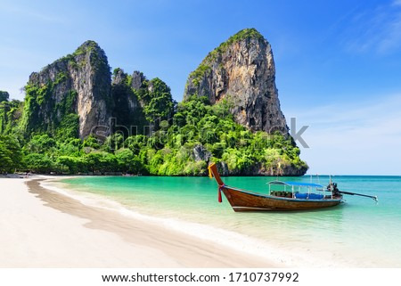 Thai traditional wooden longtail boat and beautiful sand Railay Beach in Krabi province. Ao Nang, Thailand. Royalty-Free Stock Photo #1710737992