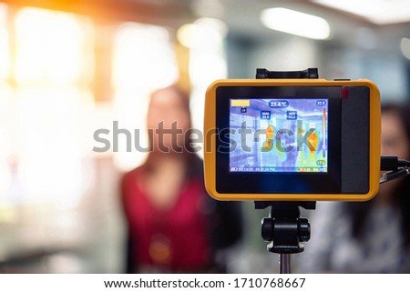 Bangkok, Thailand - March 13, 2020 : Unidentified people waiting body temperature check to access building for against epidemic flu covid19 or corona virus by thermoscan or infrared thermal camera #1710768667