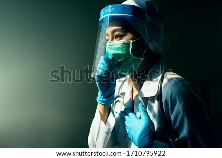 Closeup Asian female Doctor wearing face shield and PPE suit for Coronavirus outbreak or Covid-19, Concept of Covid-19 quarantine #1710795922
