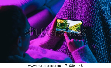 Woman stop watching film on mobile phone with imaginary video player service. Concept of online video streaming movies and series. #1710801148