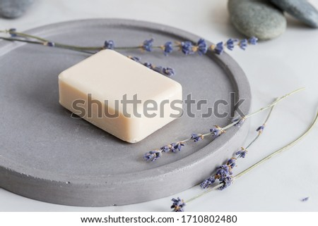 Minimal picture with sanitize soap for hand with lavender flowers at stone dish on white background. Mock up for logo and text. Free space, copy, lay out, minimal concept