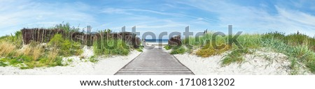 Baltic Sea Beach Dune Path, Ocean View. Sunny Weather with Clouds. Panorama Ostsee Royalty-Free Stock Photo #1710813202