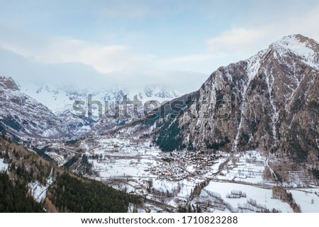 The village Palleusieux under a big mountain, in the Basin Pre-Saint-Didier, Aosta Valley at the time of corona virus outbreak, northern Italy #1710823288