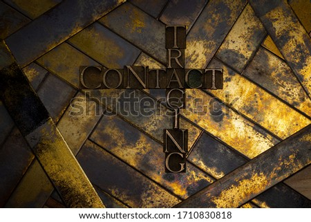 Photo of real authentic typeset letters forming Contact Tracing text in puzzle style on vintage textured grunge gold and copper complex layered background