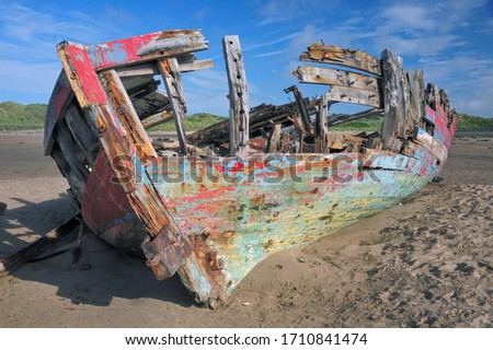 Shipwreck of fishing boat on the beach. Its the wreck of the Sea Mac trawler on the beach at Crow Point, Braunton Burrows ,North Devon,UK. Royalty-Free Stock Photo #1710841474