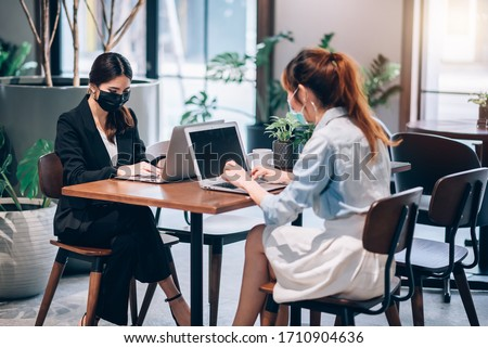 Group of Asian People Successful Teamwork Businesswoman Wearing Medical Mask and Working with Laptop. Work from Private Home Office Social Distancing among Coronavirus Outbreak Situation #1710904636