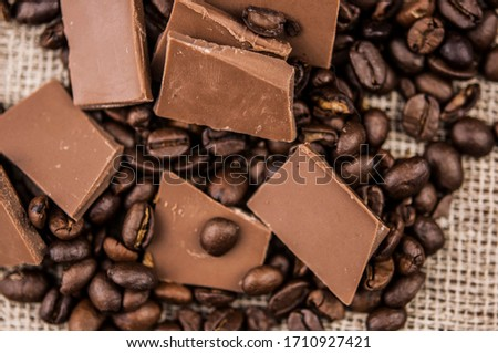 Chocolate and coffee beans on a textile background #1710927421