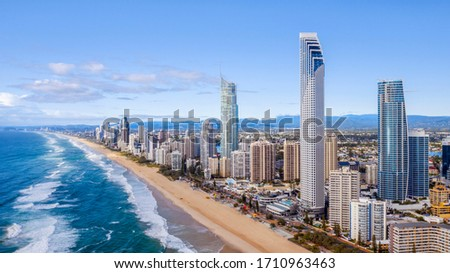 GOLD COAST, AUSTRALIA - MARCH 29 2020: Aerial view over Surfers Paradise beach and famous skyline. #1710963463