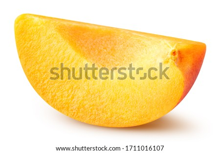 Apricot slice isolated on white background. Apricot fruit clipping path. Apricot half macro studio photo #1711016107