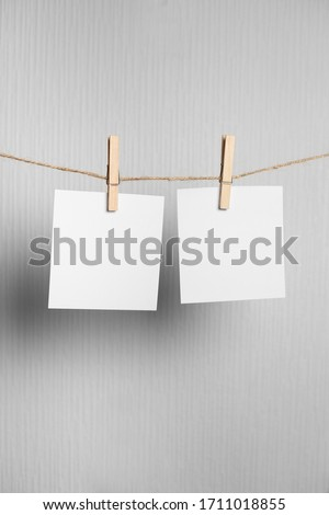 polaroid frame.Retro photo frames hanging on rope isolated on white background. real photo.four frames #1711018855