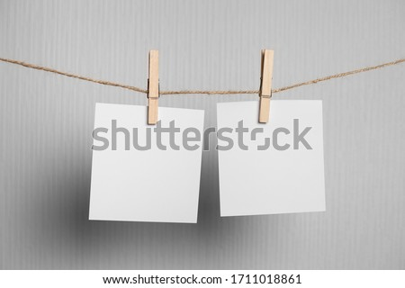 polaroid frame.Retro photo frames hanging on rope isolated on white background. real photo. two frames #1711018861