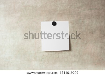 Blank polaroid photo frame with soft shadows and  magnet tape isolated on grey paper background as template for graphic designers presentations, portfolios etc. kids. magnetic board