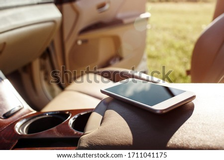 smart phone phone on the car seat dashboard. Lifestyles photo in car. Different views. Without hand, phone. #1711041175