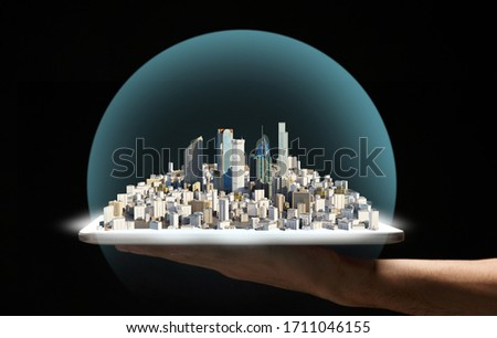 Building planning. Future virtual city on hand, under dome on black background #1711046155
