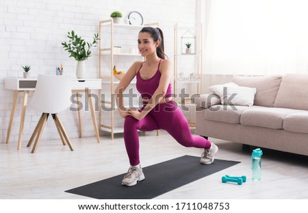 Stay home, stay active. Hispanic girl doing cardio workout in living room #1711048753