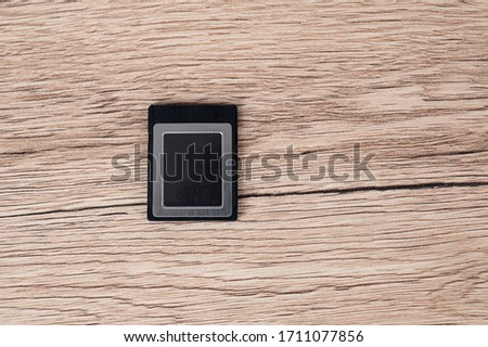 memory card dlsr black digital camera placed on a wooden table