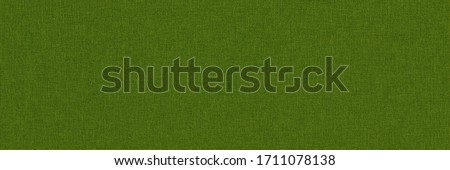 Close-up long and wide texture of natural green fabric or cloth in green yellow color. Fabric texture of natural cotton or linen textile material. Green canvas background. #1711078138