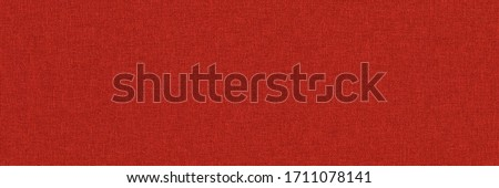 Close-up long and wide texture of natural red fabric or cloth in light red color. Fabric texture of natural cotton or linen textile material. Red canvas background. Royalty-Free Stock Photo #1711078141