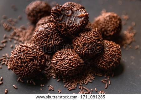 Brigadeiro (Brigadier) Traditional brazilian sweet. Chocolate candy on  dark background.  Royalty-Free Stock Photo #1711081285
