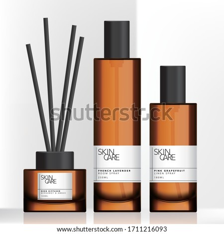 Vector Tinted Brown Glass or Plastic Tall Spray Bottle and Charcoal Reed Aromatic Home Diffuser Set Royalty-Free Stock Photo #1711216093