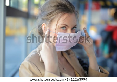 portrait of woman with a mask in a bus #1711263994