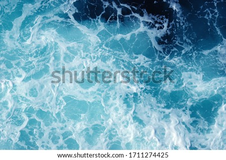 Blue sea texture with waves and foam #1711274425