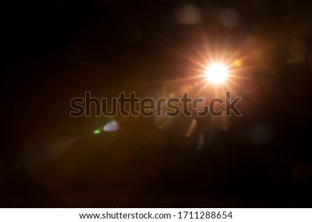 Abstract Natural Sun flare on the black #1711288654