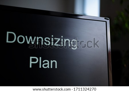 The PC monitor with a text Downsizing plan on the screen. Crisis staff reduction concept. Anti-crisis actions. #1711324270