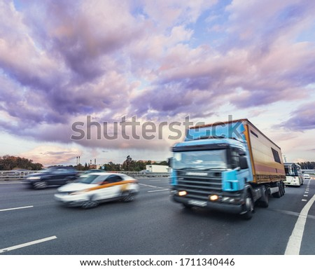 Cars move on the highway at sunset time. #1711340446