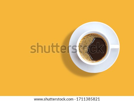 cup of espresso coffee on yellow background. Zenith #1711385821
