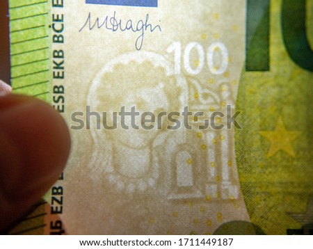 Fragment of watermark on 100 euro banknote in backlight