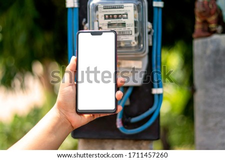 Mobile phones with white screens, including electricity meters for household electrical appliances, electricity usage concepts and electricity usage monitoring.