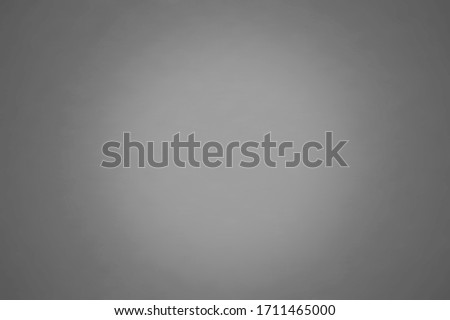 Grey color background texture with dark vignette. Gray blurred background abstract with copy space for design.   Royalty-Free Stock Photo #1711465000