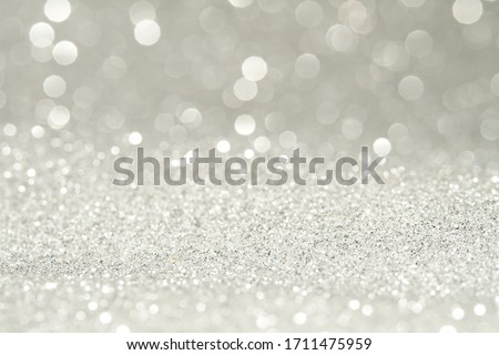 sparkles of Silver glitter abstract background Royalty-Free Stock Photo #1711475959