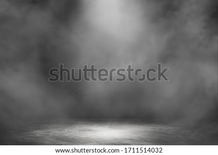 Empty space studio dark room with spot lighting and fog in black background.  #1711514032