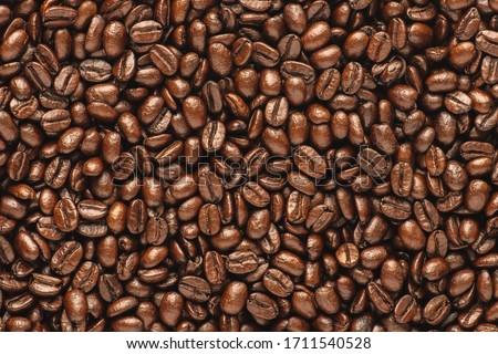 Dark roast coffee beans background, top view #1711540528