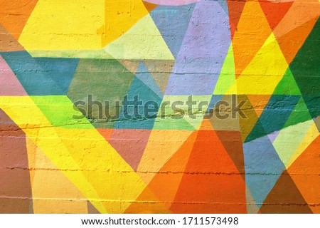 A background mosaic texture created with polygons and triangles.