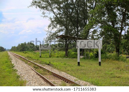 Empty train station at early morning in a country site. Scenic view in Asia showing a rural railway station with no passenger around. #1711655383