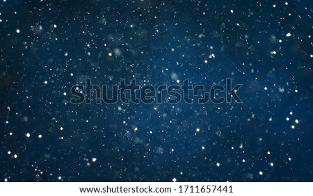 Beautiful Navy Blue Night Background with falling snow. Winter Christmas Holiday Texture. Background With Copy Space for design greetings cards or promotion flyers to Christmas and New year.