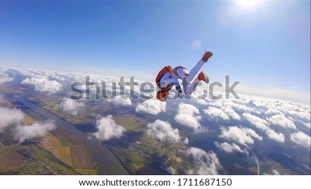 Trend. Skydiver demonstrates a suit in the sky. Beautiful views from the height of bird flight. The sky without borders. #1711687150
