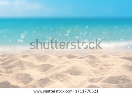 Sand with blurred tropical sandy beach bokeh background, Summer vacation and product advertisement concept #1711778521