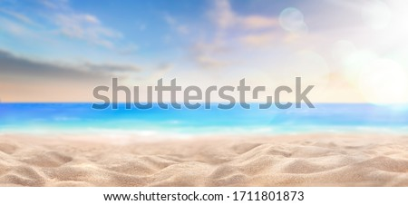A summer vacation, holiday background of a tropical beach and blue sea at sunset.
