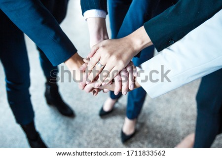 Cropped shot of women putting hands together in circle. Closeup shot of female hands. Teamwork concept #1711833562