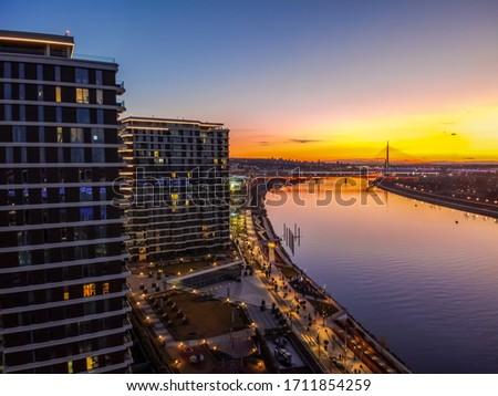 Belgrade waterfront on the Sava river at sunset. Drone view on Belgrade waterfront.Sunset in Belgrade, Serbia. Royalty-Free Stock Photo #1711854259